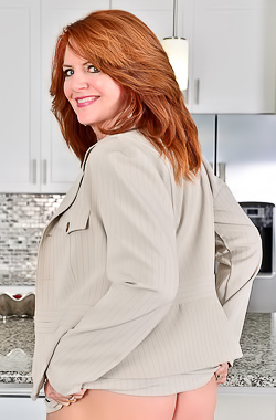 Andi James Mature business lady Andi James gets rid of her costume